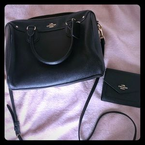 Small black Coach bag with wallet